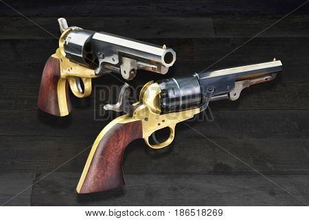 American wild west pistols called six shooters.