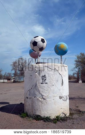 Road decoration. Balls made from missle high pressure air tanks in colors Russian and Kazakh flags.Former Soviet anti-ballistic missile testing range Sary Shagan.May 6, 2017.Priozersk.Kazakhstan