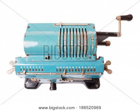 Old blue calculating machine isolated on a white background. Top view.