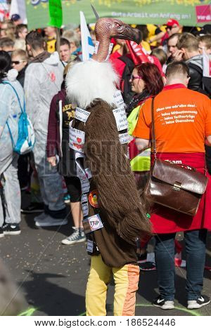 BERLIN - MAY 01 2016: An activist in the neck suit. Members of trade unions workers and employees at the demonstration on the occasion of Labour day.