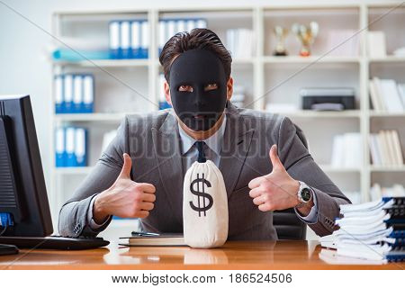 Businessman with mask in office hypocrisy concept