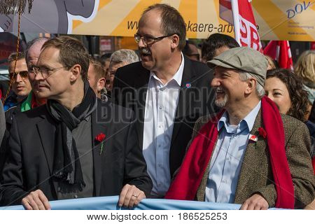 BERLIN - MAY 01 2016: Governing Mayor of Berlin Michael Mueller (left). Members of trade unions workers and employees at the demonstration on the occasion of Labour day.
