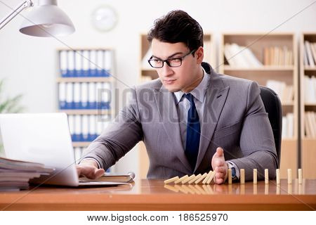 Businessman with dominoes in the office
