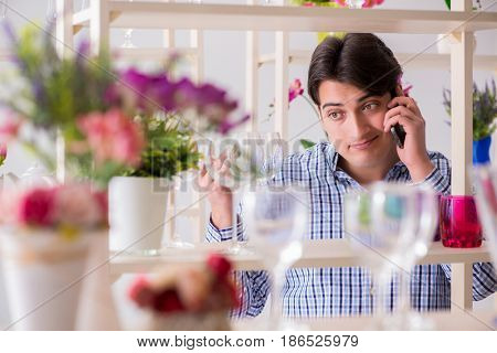 Man shopping in shop and calling his wife