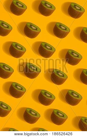 Colorful pattern of kiwi. Top view of the sliced kiwi. Kiwi on a yellow background