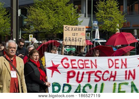 BERLIN - MAY 01 2016: The woman with the poster