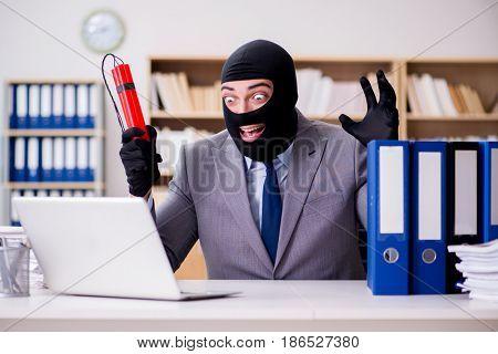 Criminal businessman with balaclava with dynamite