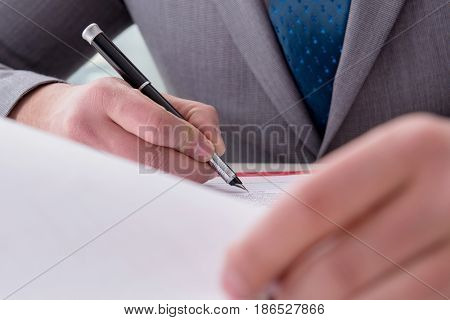 Businessman taking notes at the meeting