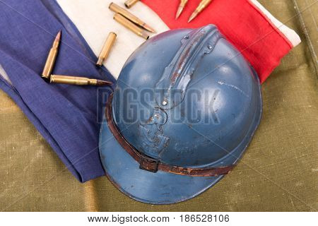 french military helmet of the First World War on a red white blue flag