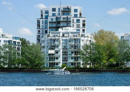 BERLIN - MAY 08 2016: Luxury apartment building on the bank of the Spree on the Stralau peninsula the district Friedrichshain.