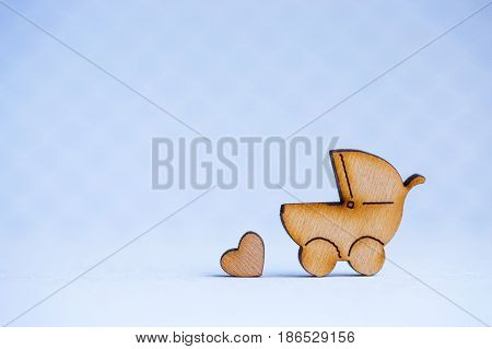 Wooden Icon Of Baby Buggy And Little Heart On Gray Background