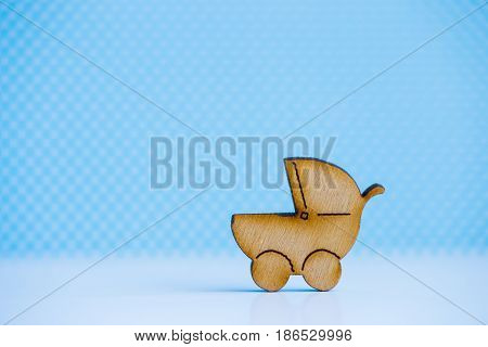 Wooden Icon Of Baby Buggy On Blue Background