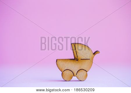 Wooden Icon Of Baby Buggy On Pink Background
