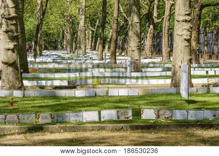 BERLIN - MAY 09 2016: Victory Day in Treptower Park (Soviet war memorial). Mass grave of fallen soldiers and officers who liberated Berlin from the Nazis. Signs with names and date of death.