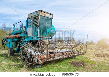 Old Rusty Combine Harvester Equipment In An Abandoned Collective Farm.