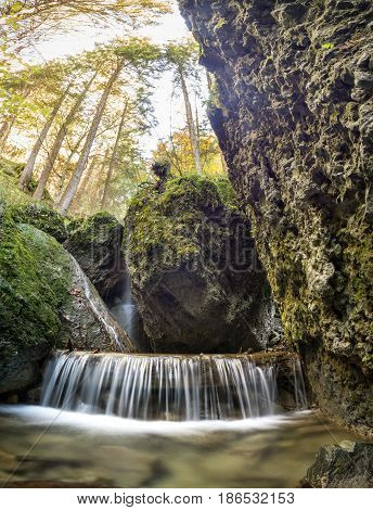Nice waterfall in a narrow gorge. Allgau Alps.