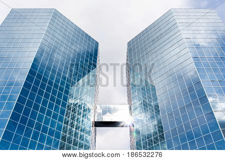 Two octagonal Skyscrapers reflecting clouds and sky in the glass fronts. The Commerce Place buildings in Hamilton, Ontario, Canada. CIBC. Canadian Imperial Bank of Commerce. FEBRUARY 2009.