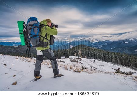 Photographer With A Camera In Carpathians