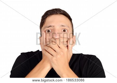 Portrait of a young man shocked. Isolated white background.