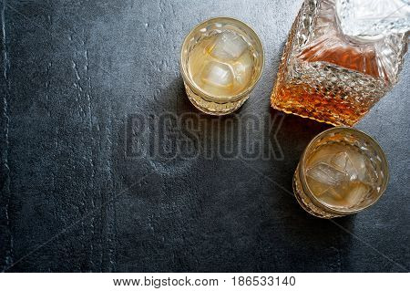Glasses Of Whiskey With Ice Cubes On Stone Table. Top View