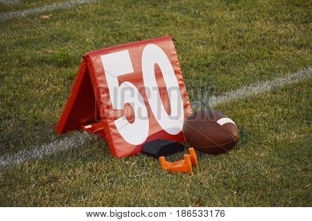 Fifty yard line marker with a football