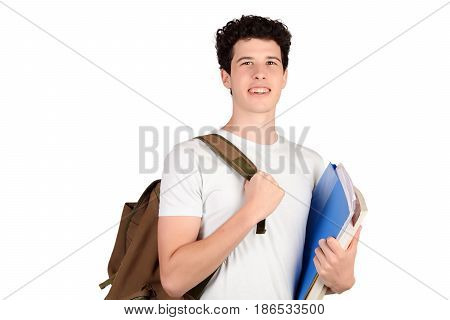 Portrait Of Young Student Holding Notebook.
