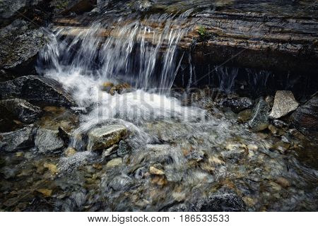 nature background A small waterfall through the wood