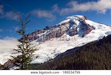 Thick Glaciers slide down Mout Baker in the North Cascade Mountains