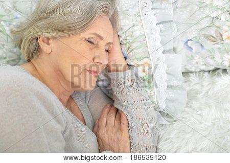 Portrait of a beautiful elderly woman sleeping