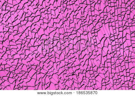 Texture of the broken glass, pink broken glass texture