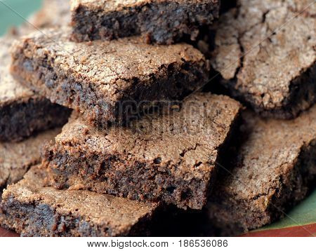 Close up of Dark Chocolate Brownies on a plate viewed from above.