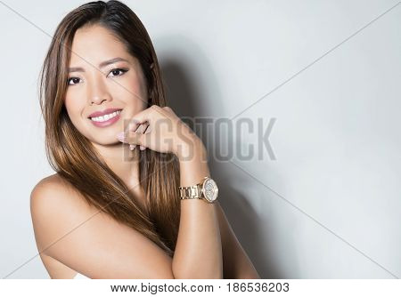 beautiful young asian woman with wrist watch