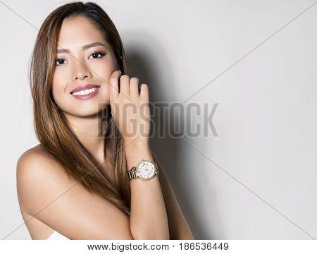 beautiful young asian woman with wrist watch