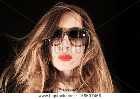 Face Of  Young Woman Dressed In Sunglasses