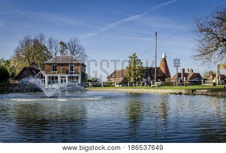 GOUDHURST, KENT, UK, 31ST OCTOBER 2014 - Pond and fountain in the pretty village of Goudhurst Kent UK