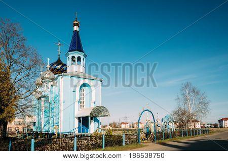 Village Krasnoe, Gomel Region, Belarus. Old Orthodox Church Of The Assumption At Sunny Spring Day. Famous Landmark.