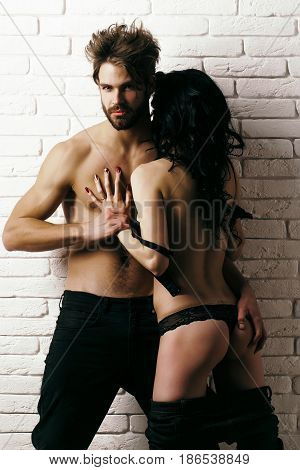 Sexy Couple Embraces At Wall