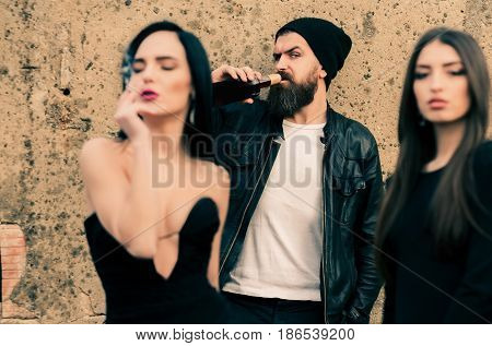 Female Smoking Cigarette With Friends