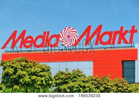 Nowy Sacz Poland - 15 May 2017: Sign of a Media Markt store on the blue sky. Mediamarkt is a German chain of stores selling consumer electronics with numerous branches throughout Europe and Asia.