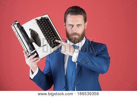 Business Man In Blue Suit And Tie With Typewriter