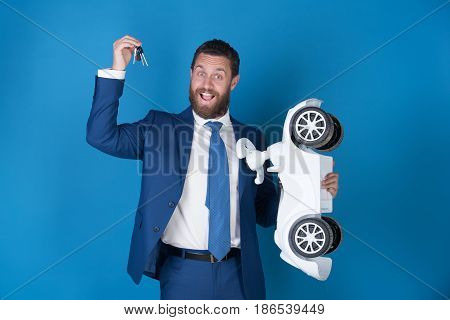 Happy Man Wearing Suit With White Toy Car, Keys