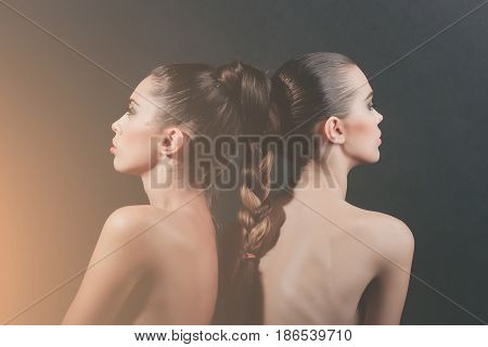 Two Cute Women With Tied Long Hair Into Braid