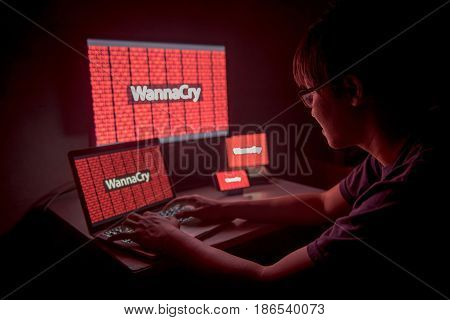 WannaCry ransomware attack on desktop screen, notebook and smartphone, cyber attack internet security concept