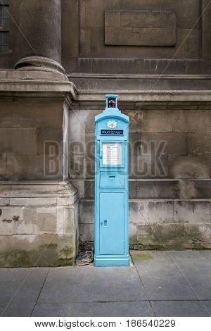 Blue police public call post an original free police telephone box