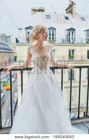 Beautiful Young Bride On The Balcony Of Her Home Or Hotel Room