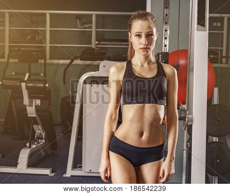 Young woman at the gym exercising beutiful still life