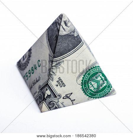 Origami dollar pyramid money symbol business on a white background