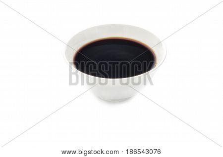 Unagi sauce in white bowl isolated on white
