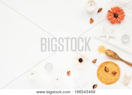 Spa Composition. Sea Salt, Orange Flowers, Spa Candles, Bath Towel On White Background. Flat Lay, To