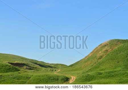 Landscape With A Trampled Path, Passing Through A Wonderful Green Mountainous Terrain. Photo Of Beau